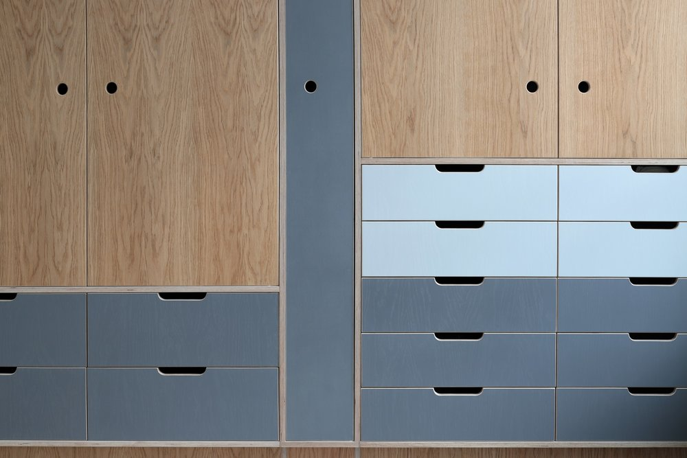 Detail of Robin's large fitted bespoke wardrobe, made from oak and plywood by Lozi, in East London