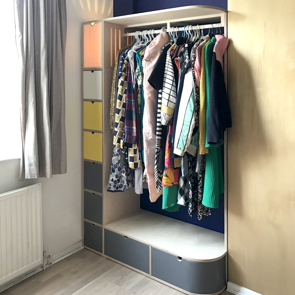 Julia's colourful bespoke plywood fitted wardrobe by Lozi