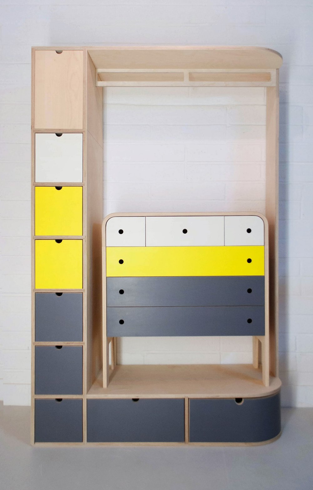 Julia's colourful bespoke plywood fitted wardrobe and chest of drawers by Lozi