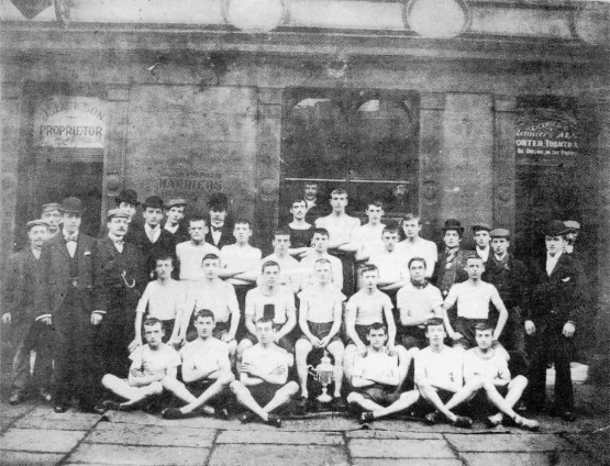 A young Joe seated third from the right with his fellow Bolton Harriers in 1900.