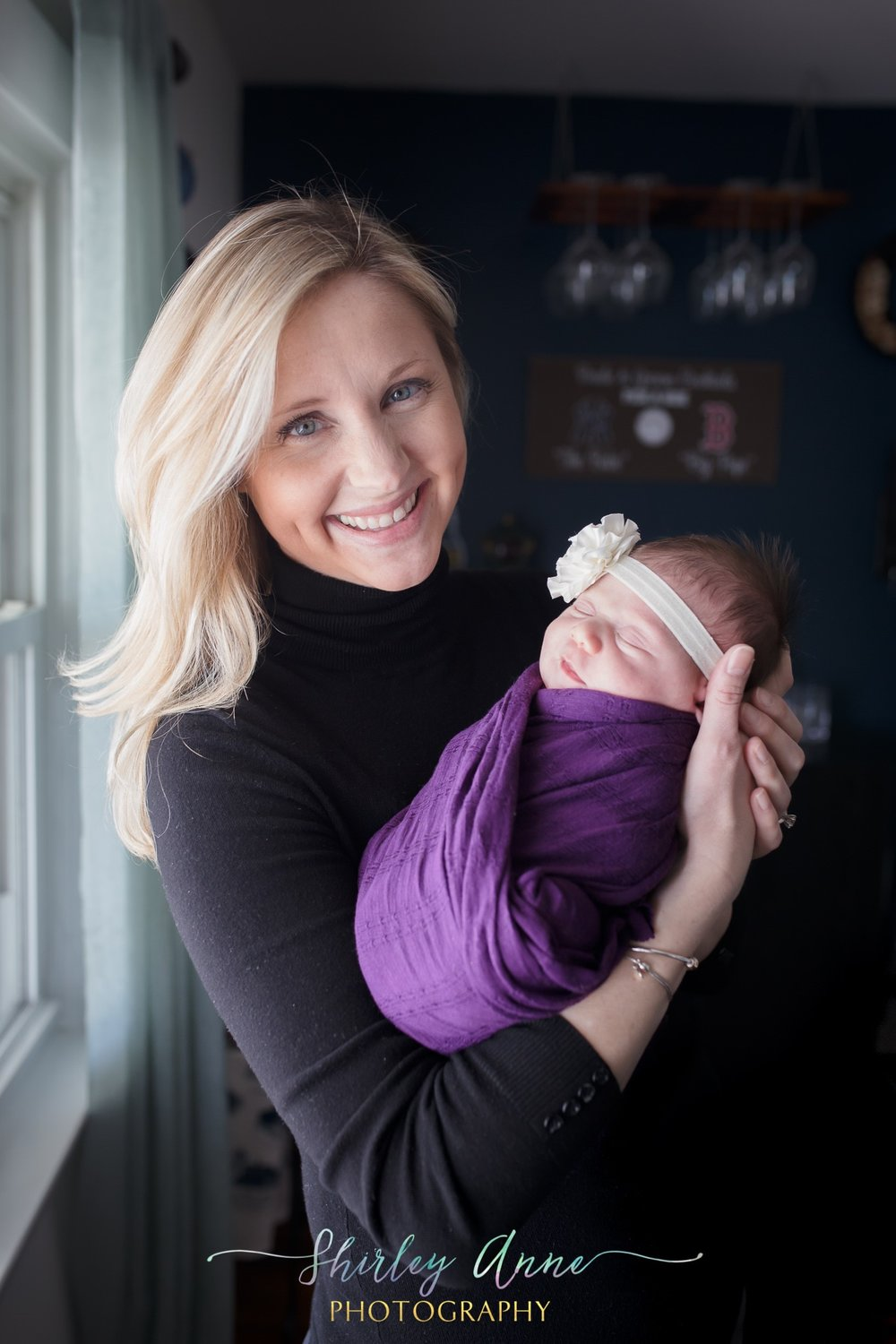 mother holding baby during newborn session