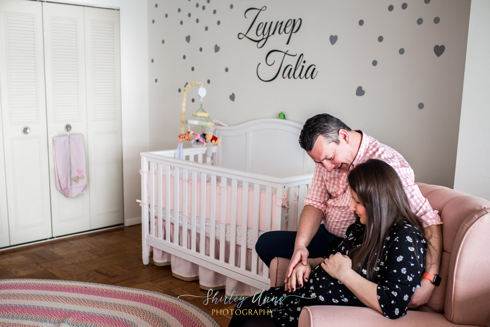 home session with pregnant mom and father in nursery room