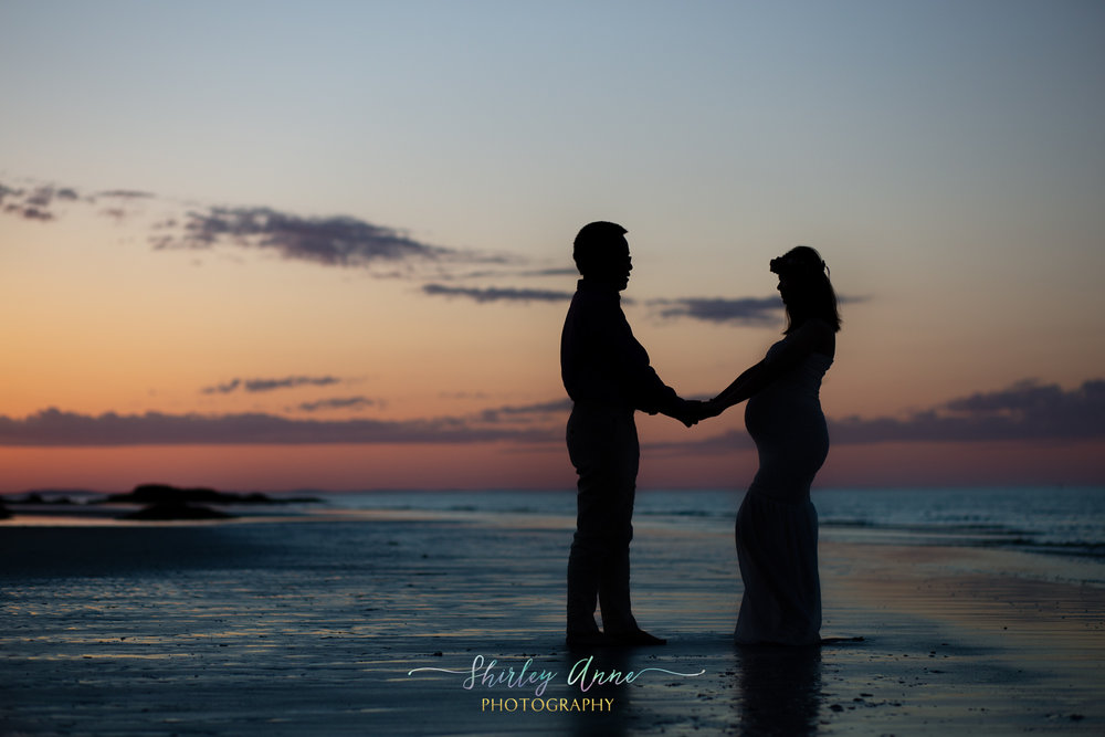 beach silhouette maternity session