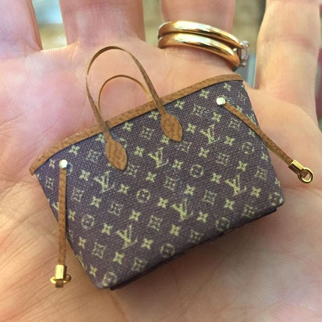 Coveting this #minilouie that is an exact replica of mine.  Total #buyersremorse that I didnt grab it this weekend at @whimsiesdollhouseshop . . . . #louisvuitton #dollhouse #miniature #miniac #miniatureaccessories #purse #myminilife