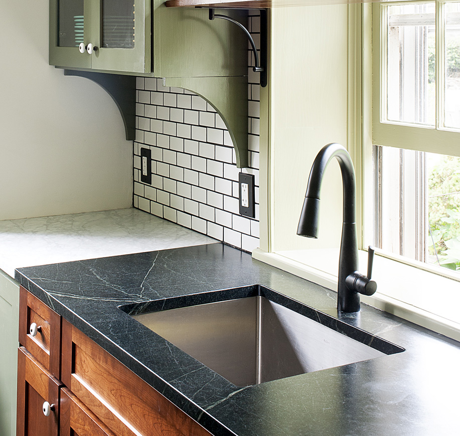 This soapstone has distinctive veining with a hint of green.