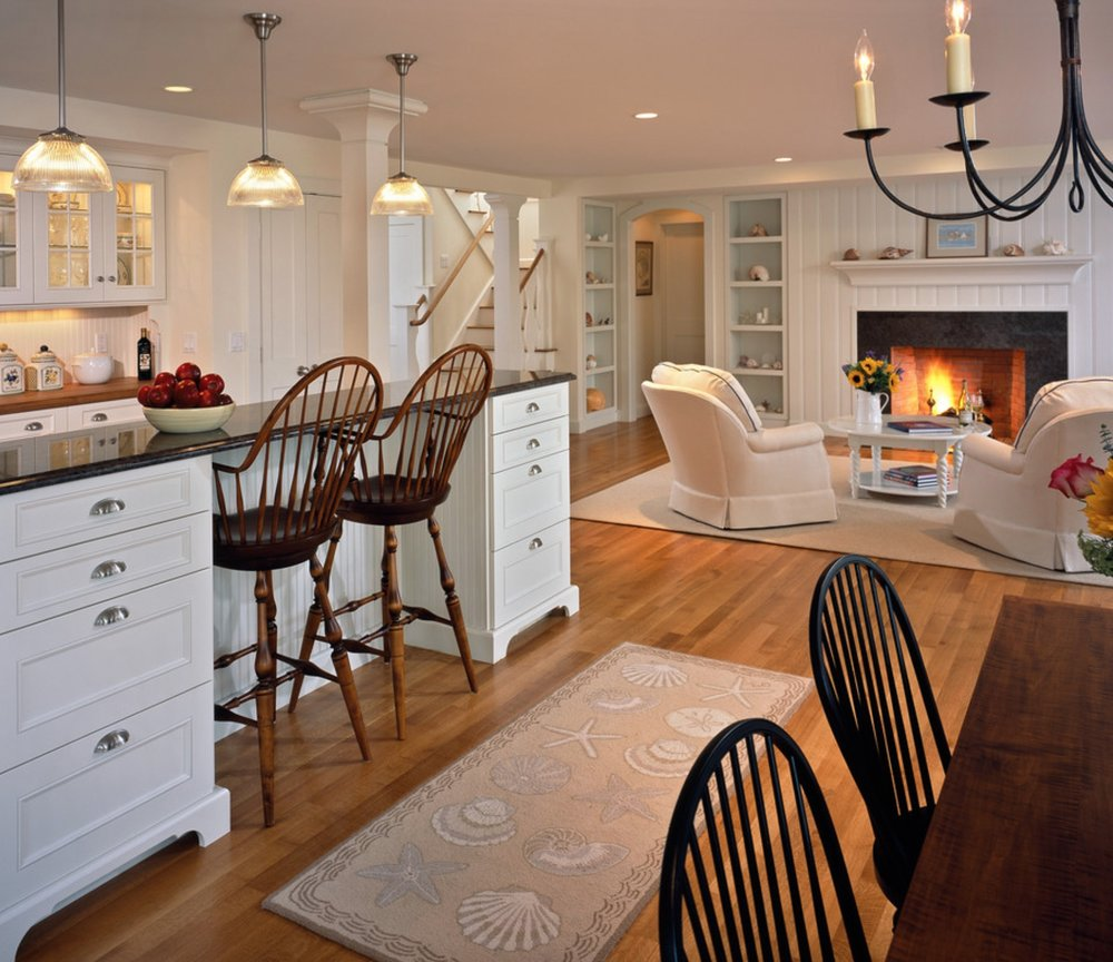 The lounge chairs on the right can swivel to enjoy the fire and the company.
