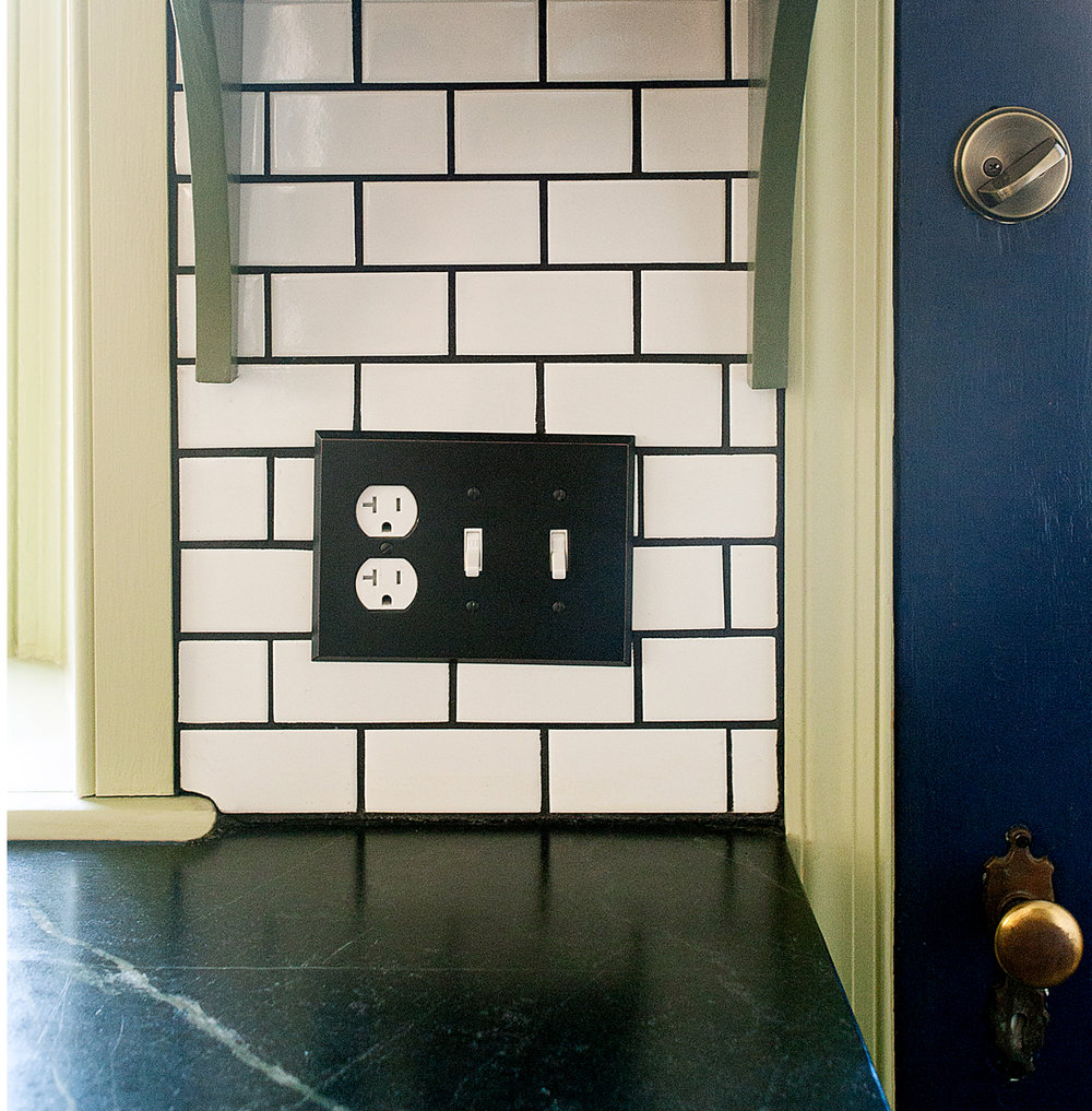 This outlet is easy to access and grouped with two light switches.