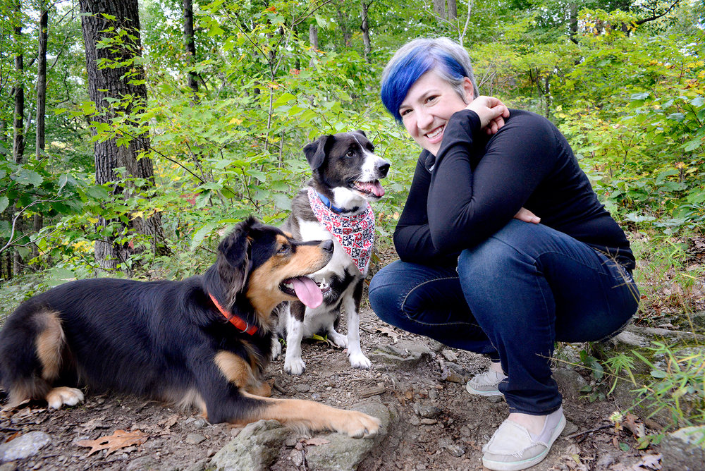 Adina Silberstein hiking with her dogs.