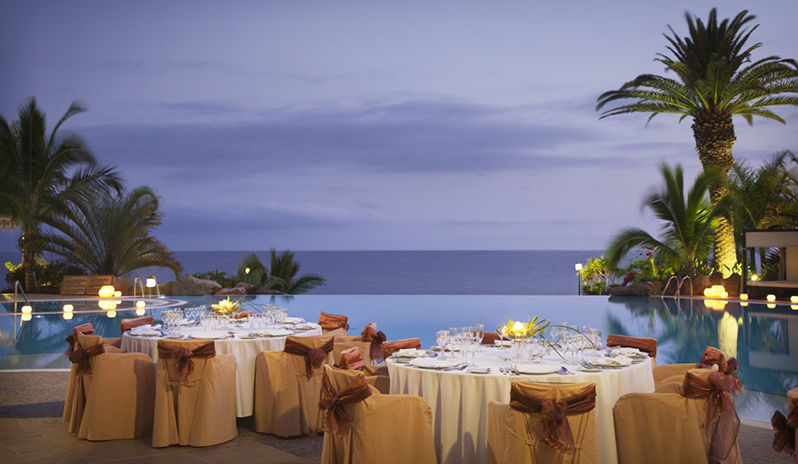 Dinner set up by the infinity pool and the ocean views
