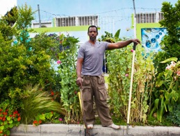 Ron Finley in front of his parkway garden.  Photograph source: Ron Finley via Los Angeles Magazine