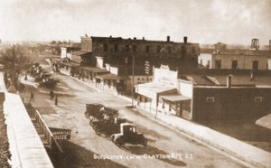"Main Street – North Side. A view of Clayton Shows Main Street before 1917 when A.W. Thompson built what is now the Shrine of the Testaments on the corner of First Street. Note the Eklund Hotel's second Story ""opera balcony."""