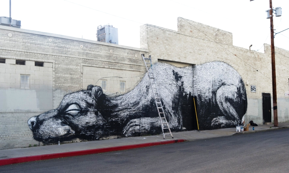 Sleeping rat mural by Roa