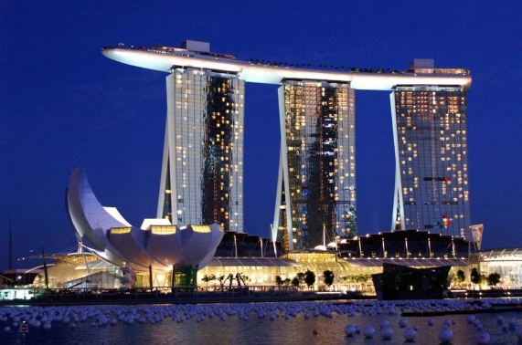 Marina Sands Hotel is a mini city within the overpopulated city of Singapore. Perched atop the hotel's three 55-story towers is the Skypark, which features an observation deck, spa and infinity pool. The hotel also features 15 restaurants and five nightclubs and lounges.