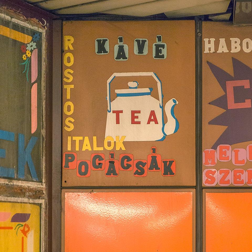 Lovely vinyl graphics and lettering adorning the Pumukli cake shop kiosk in Budapest's Lehel tér Metro 3 station.