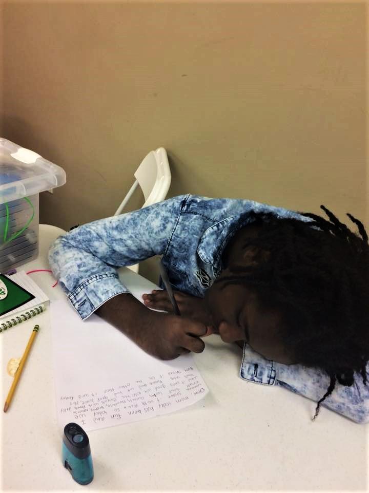 literacy girl writing mixed programming.jpg