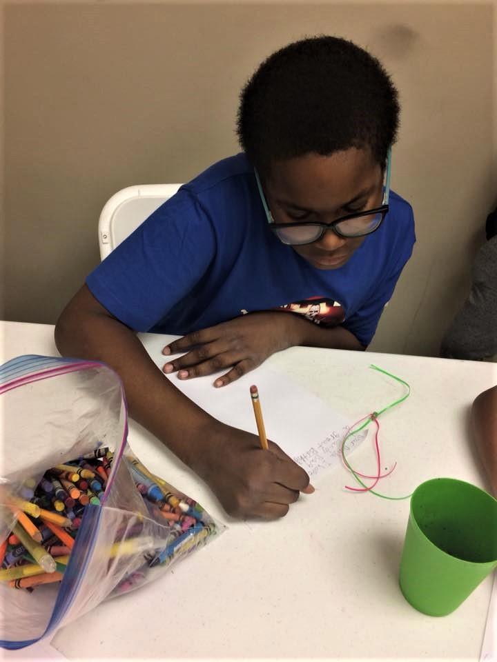literacy boy writing mixed programming 2.jpg