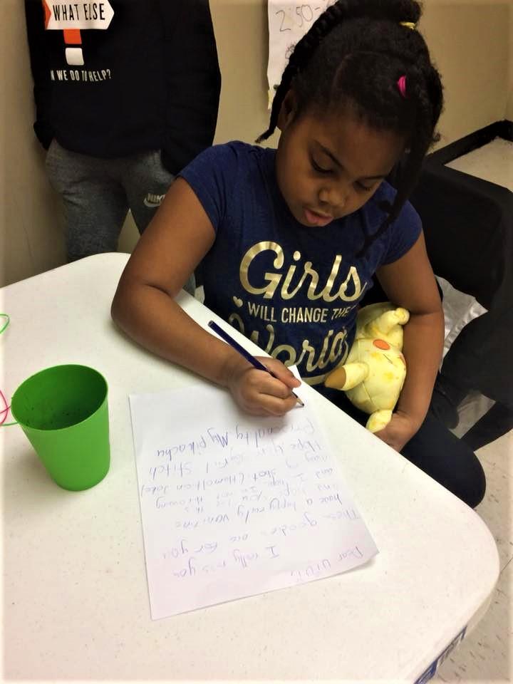 literacy girl writing.jpg