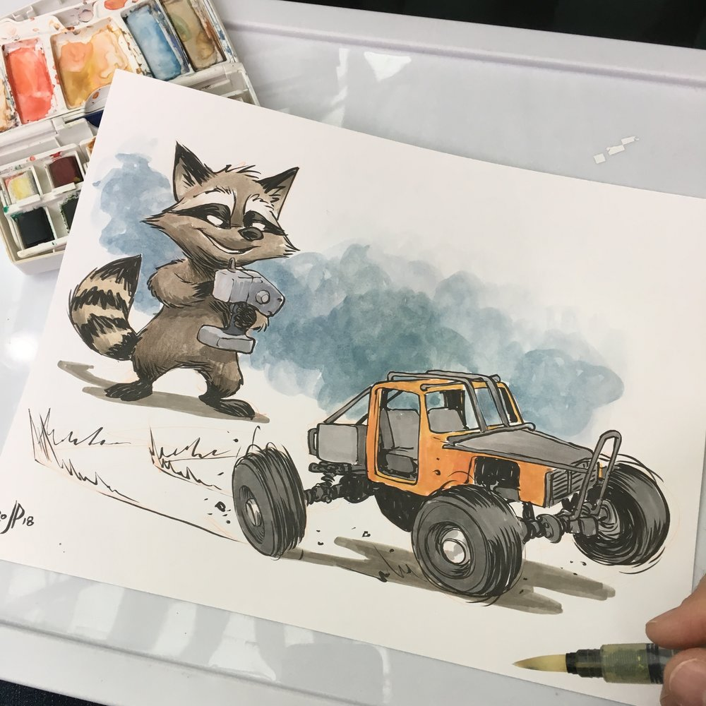Sometimes you just want a picture of a raccoon with a remote controlled car.