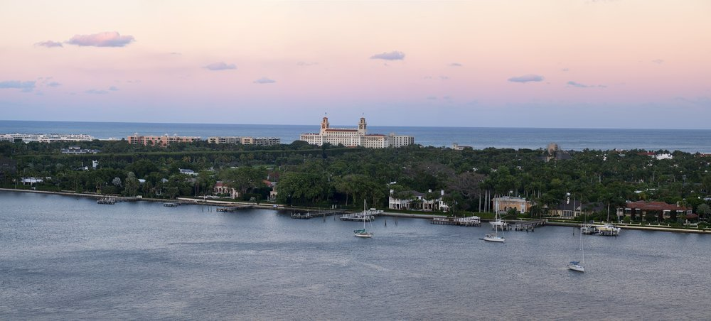 Panorama view of The Breakers resort and the island of Palm Beach—set against a stunning sunset