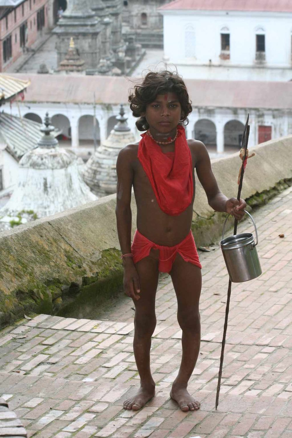 A begging child, posing as sadhu in Pashupati, deformed from chronic malnutrition. About 49% of Nepalese children under 5 years old suffer from stunting, a measure of chronic malnutrion, which is one of the highest rates in the world.