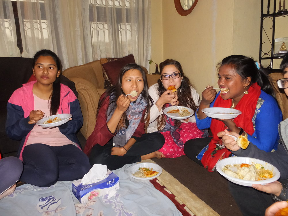 Older girls enjoying a good meal in their hostel.