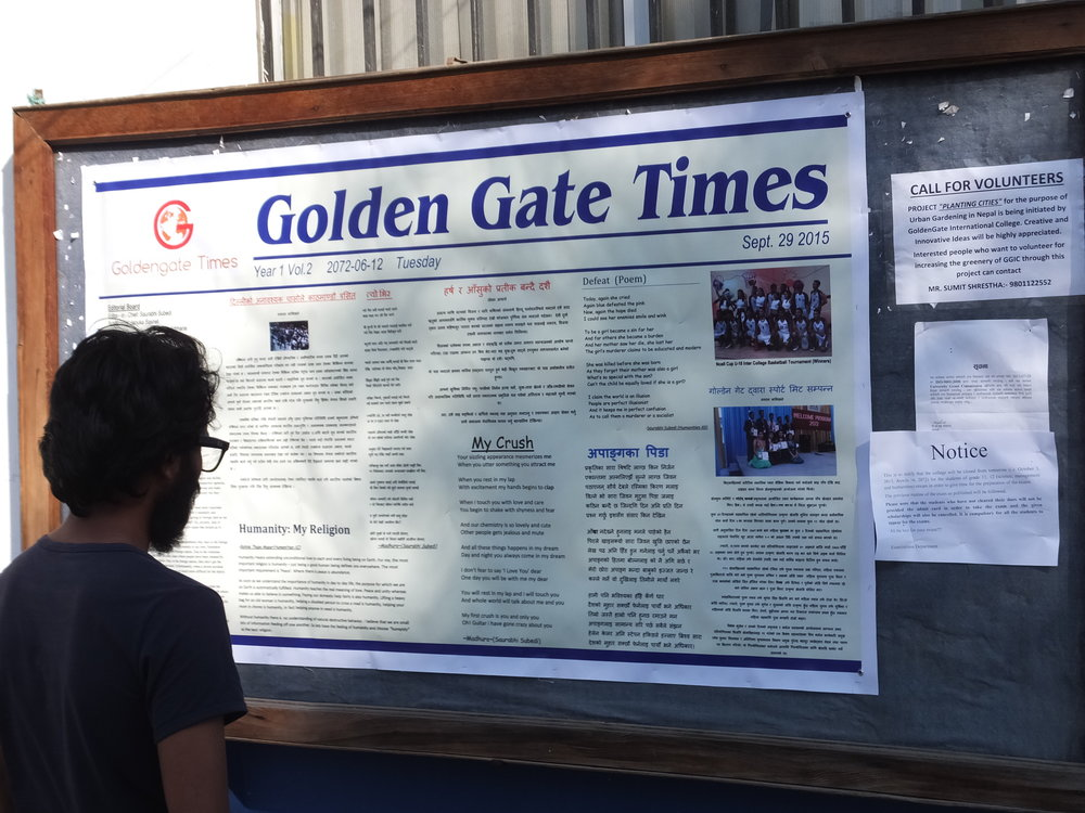 Rukesh reading the latest news at Golden Gate College where many of our children attend 11th/12th grade.