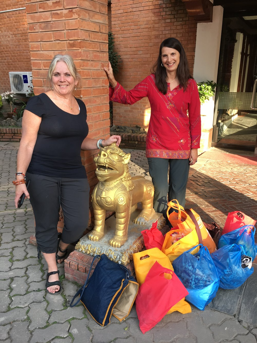 Christine and Reva finish the Holiday Bazaar shopping in Nepal- WHEW!