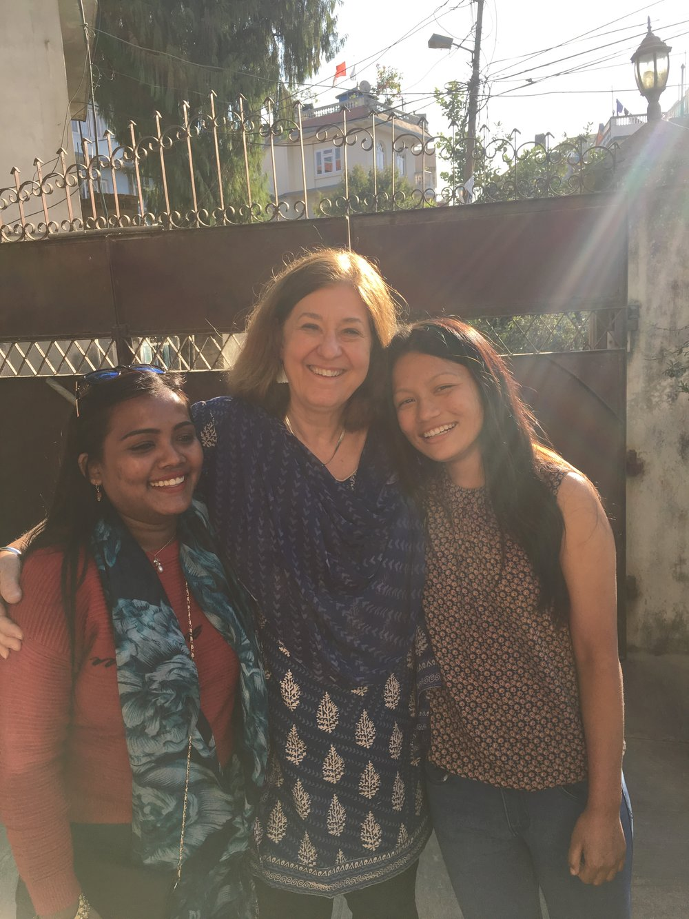 Sponsor Nancy Williger hugs both her sponsored girls!