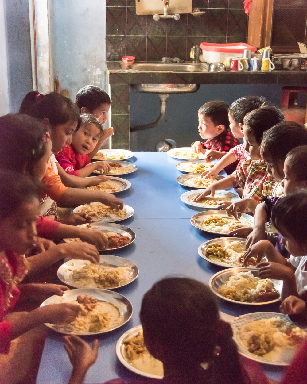 Contact Center kids enjoy their extra daily meal provided by Karma Thalo.
