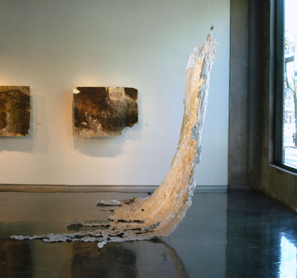 Installation view. Plaquemine Pour, 2011, Linen Rag Papercast of Levee, 10' x 15'