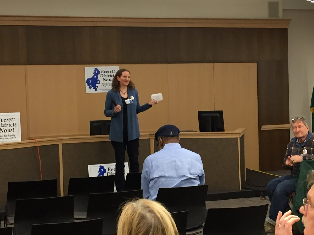 Megan Dunn, Chair of Everett Districts Now, explaining the history of outreach and community education on the 5-2 plan.