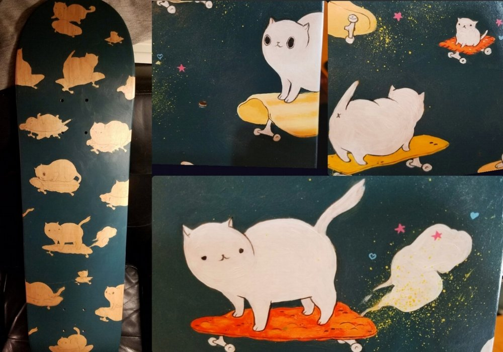 Acrylic on skateboard painting, of cats on chip skateboards.