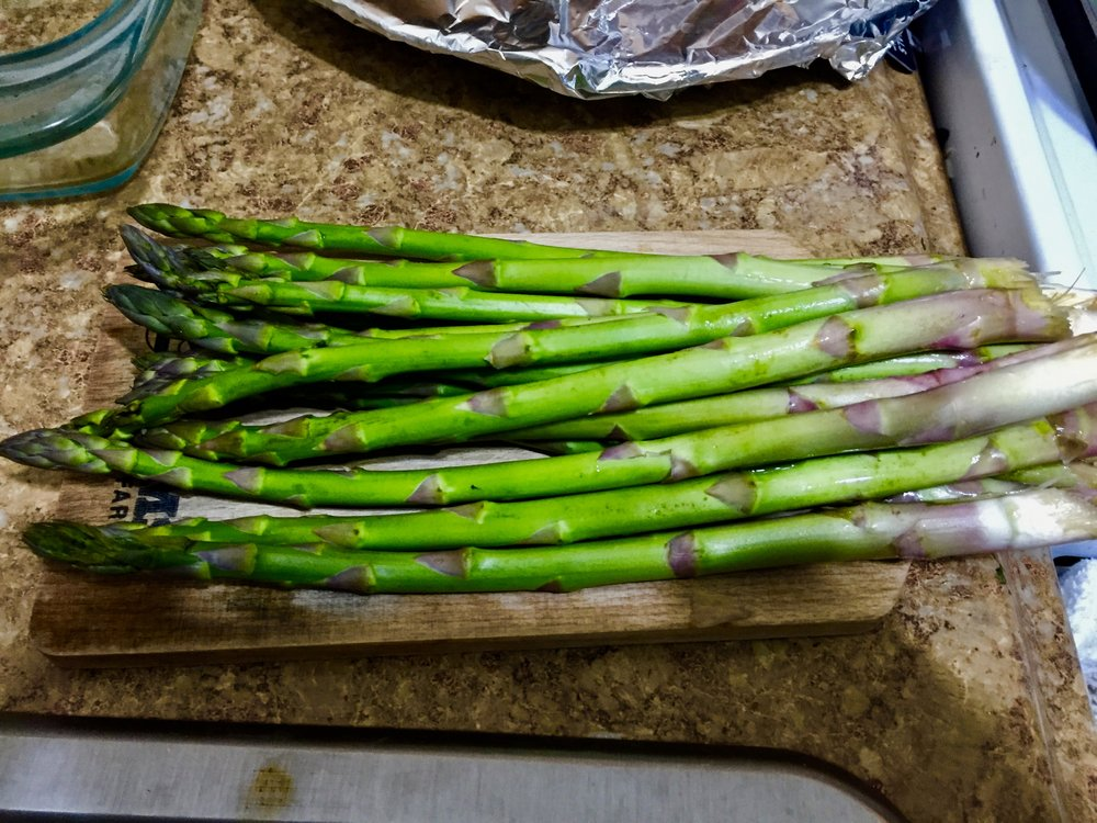 Trim Asparagus and cut each stalk into thirds. When the orzo has cooked for 9 minutes, add the asparagus, 0.25 cup of grated parmesean, and lemon juice. Mix throughly