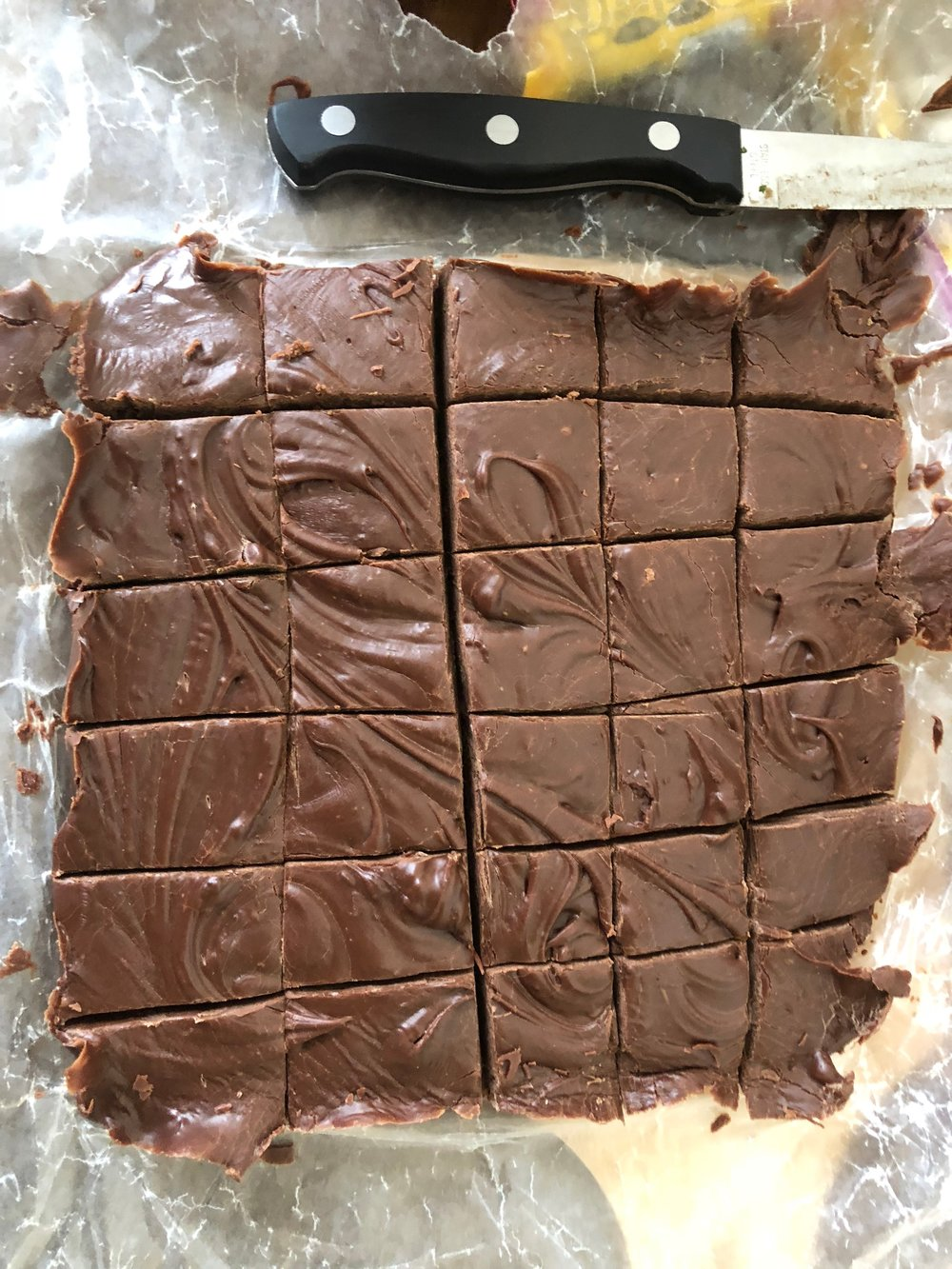 Cut the opposite direction to make approximately uniform squares of fudge.