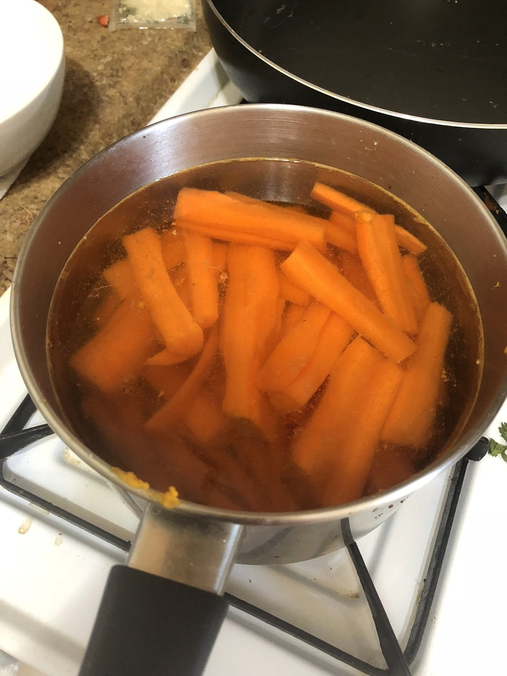 Bring carrots a boil, watching carefully so as not to overcook