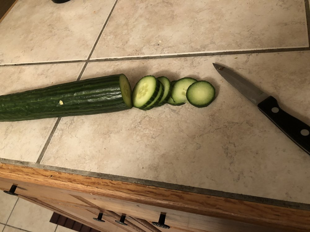 Slice the cucumber into thin coins.