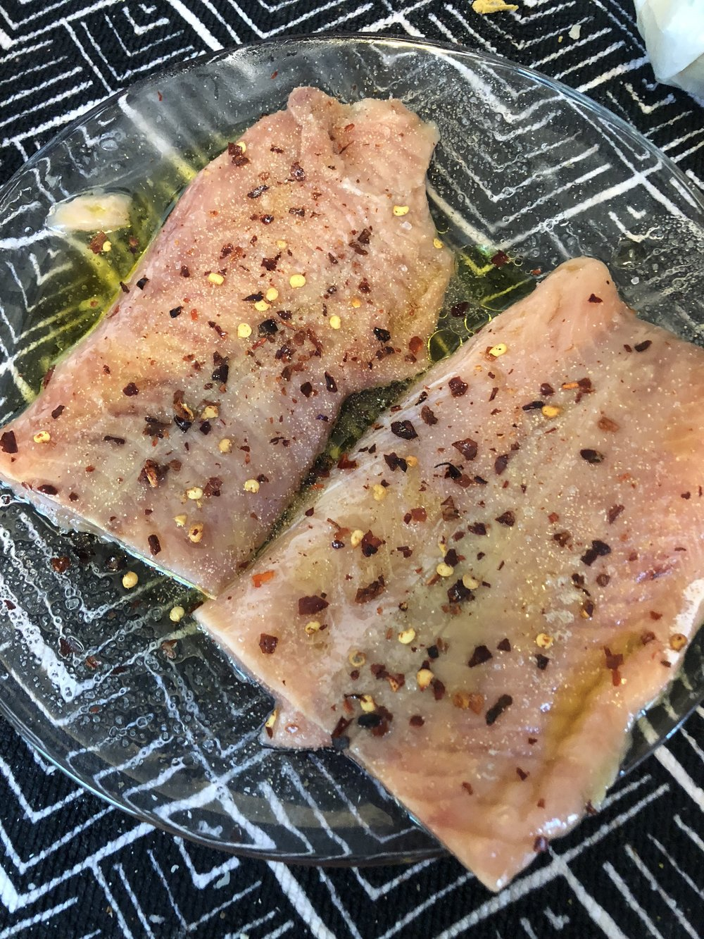 Coat salmon steaks with olive oil and season with salt, pepper, red pepper, garlic and lemon,