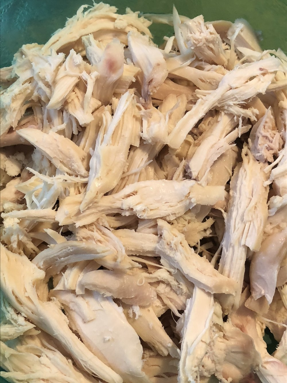 Strain the chicken stock into another pot, being careful to keep all the liquid for the stock of your soup. Remove the chicken from the pot and when it is cool, clean the chicken into shredded bite sized pieces.  Set aside
