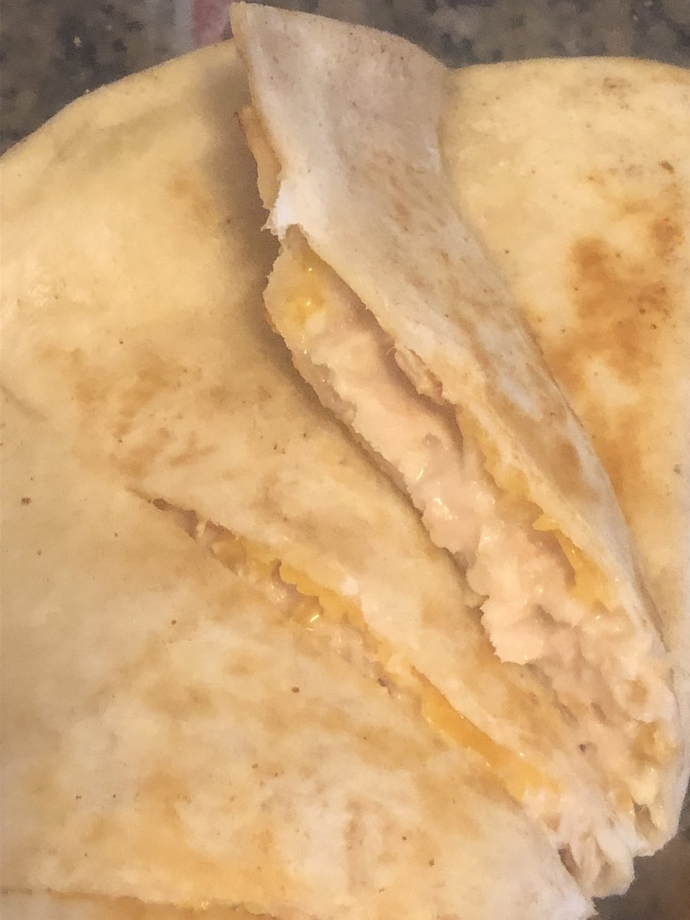 Ingredients  can of tunafish (white/albacore) - I used bumblee  2 tbls of mayonnaise  medium pan sized flour quesadillas  shredded (preshreded or shred your own) cheddar cheese  for garnish - barbecue sauce or salsa  pat of butter