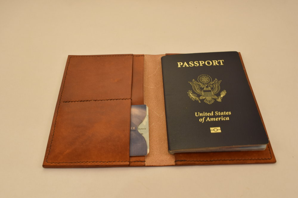 Passport Wallet- Starting at $95 - Travel around the world in style while keeping your passport safe from damage with a hand-crafted passport wallet...Learn More