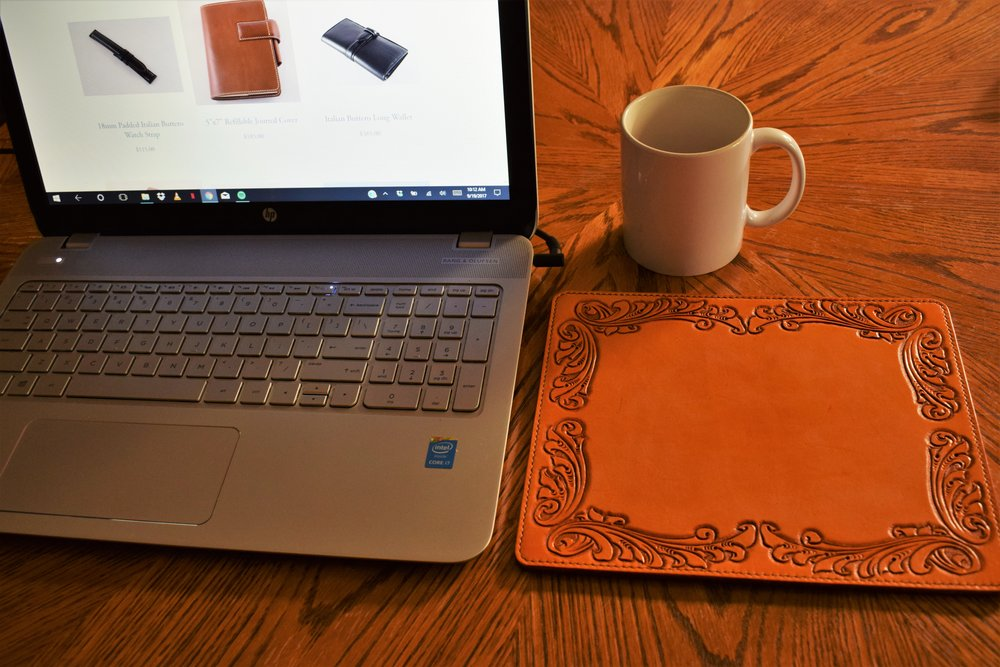 Computer Mouse Pad- Starting at- $50 - An example of the little things making all the difference, and hand-crafted computer mouse pad can brighten a personalize your bleak workspace...Learn More