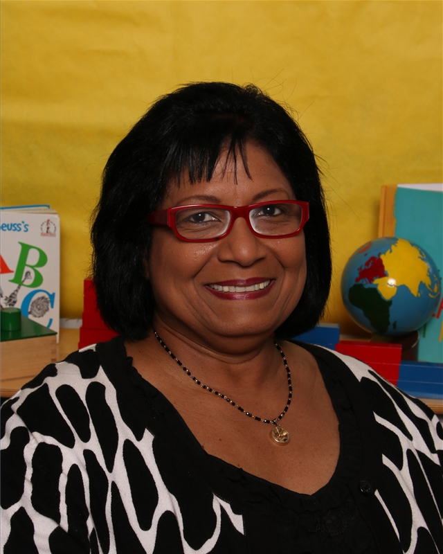 "Cheryl Denner, Floater Teacher Ms. Cheryl is one of our original teachers at MDS. She was born in Trinidad, where she studied business administration at St. Mary's College. She's been teaching at MDS since 1988, working with every age group of children in the school, and is a certified Montessori teacher. In 1992 she became the lead teacher of the first infant/toddler class at MDS, The Puffins, and held that position for the next 14 years. In 2002 Cheryl was awarded ""Woman of Distinction"" honors by the Y.W.C.A. for her dedication and contribution to the community. ""Each day is a joyful experience for me as I prepare a peaceful learning environment in the classroom, and I am always looking forward to working with each child's unique approach to learning, as they follow their own independent ideas."" Cheryl lives in Brooklyn with her daughter, and enjoys traveling, costume design, music, and story-telling combined with music and art."