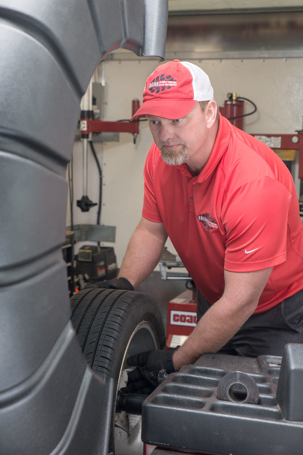 Larry Burch with tire balancer