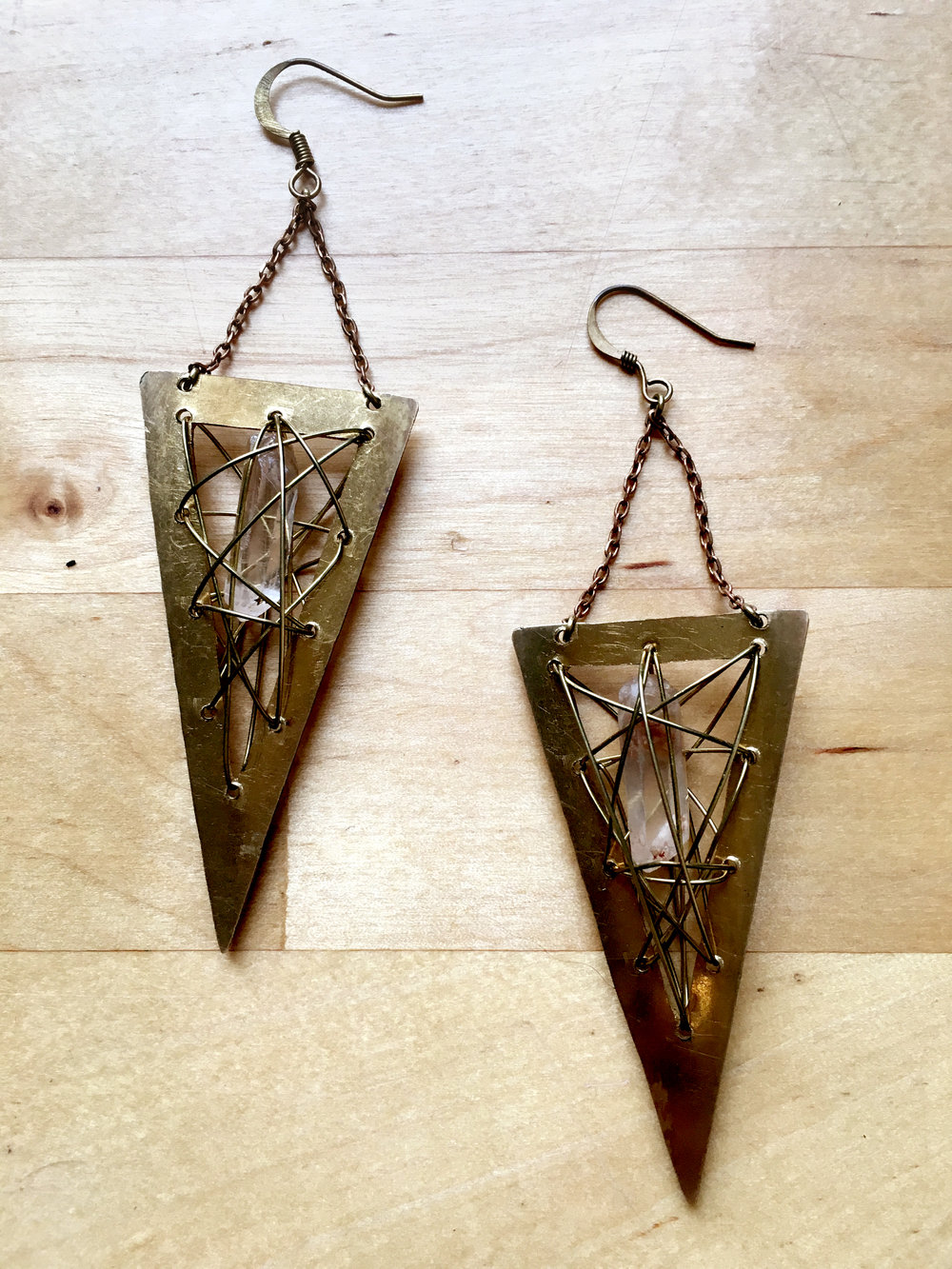 cg earrings on wood.jpg