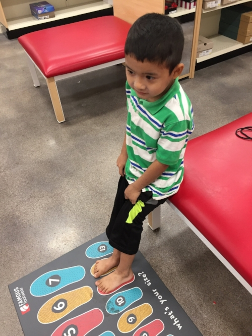 Moo Kpaw Htoo finds out his shoe size.