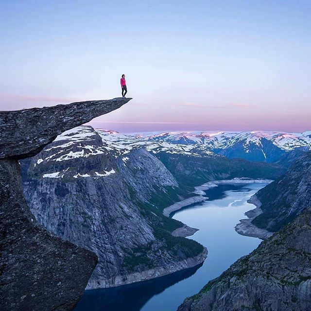 "Every once in a while you just have to do those things that most people think are ""crazy"". Like heading out at 11PM and hiking through the night to get to get to a place like #Trolltunga, just so you can arrive just in time for sunrise and get the whole place to yourself.⠀ ⠀⠀ Crazy? A little. Worth it? We'll let this shot by @j_bonde speak for itself.⠀ ⠀⠀ #ChasingSunrise⠀ #MakeItCount"