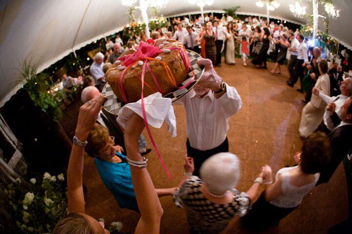 A wedding ake makes it's way around the dance floor