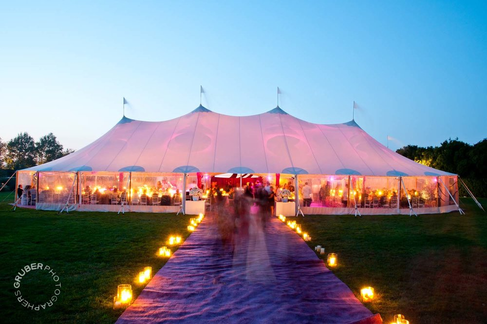 A well lit tent at sunset