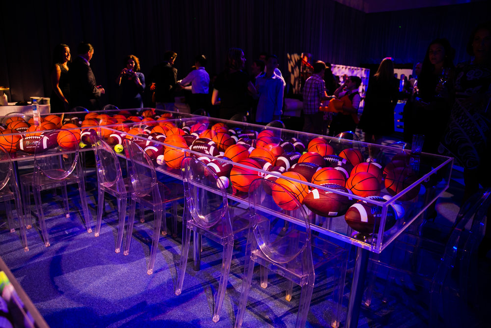 Custom clear acrylic tables filled with basketballs