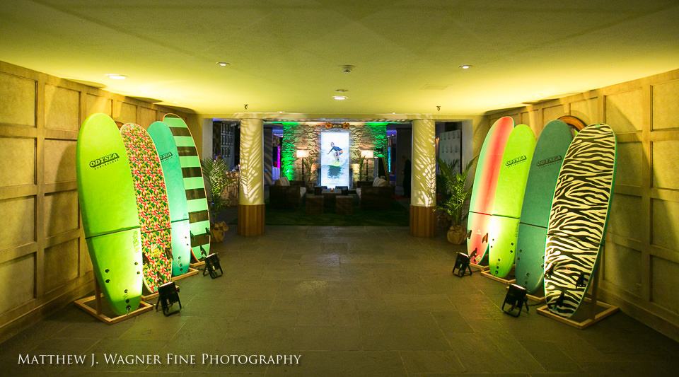 Guests are greeted by rows of surfboards